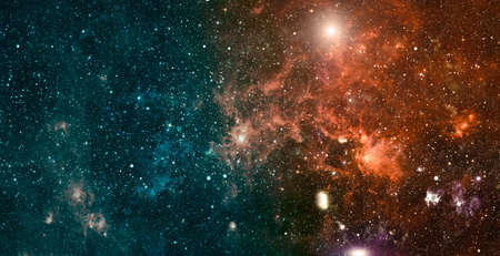 Space background with stardust and shining stars. Realistic colorful cosmos with nebula and milky way. Stock Photo