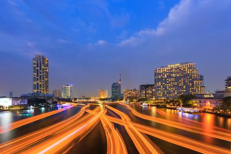 plano: Bangkok river view at Dusk with modern business building along the Chao Phraya river Thailand