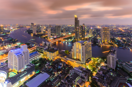 plano: Bangkok river view at Dusk with modern business building along the Chao Phraya river Thailand