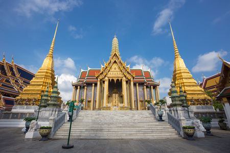 grand palace: Wat Phra Kaew, Temple of the Emerald Buddha with blue sky in Bangkok, Thailand Stock Photo