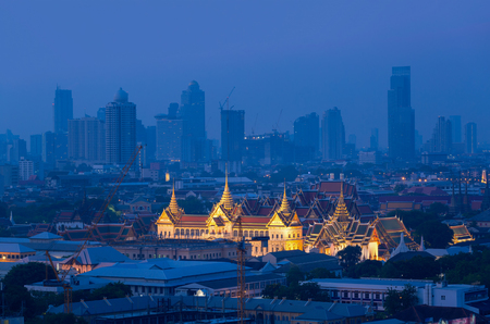 The Golden Grand Palace of Bangkok with Bangkok skyscraper view of cityscape at sunrise time. The most favorite landmark of travel destination of Bangkok. Best of amazing beautiful scene of Thailand