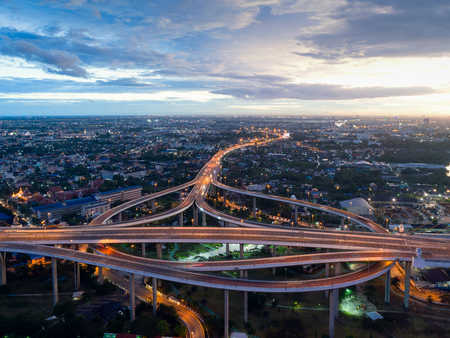 Top view over the highway,expressway and motorway at night, Aerial view interchange of a city, Shot from drone,Expressway is an important infrastructure in Thailand Stock Photo