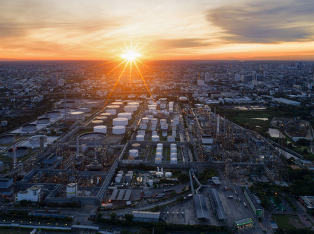 aerial bomb: Twilight of oil refinery ,Shot from drone of Oil refinery and Petrochemical plant at dusk , Bangkok, Thailand Stock Photo