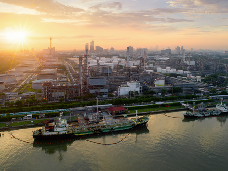 Aerial view of twilight of oil refinery ,Shot from drone of Oil refinery and Petrochemical plant at dusk , Bangkok, Thailand