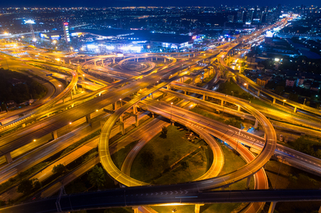Bangkok Expressway top view, Top view over the highway,expressway and motorway at night, Aerial view interchange of a city, Expressway is an important infrastructure in Thailand