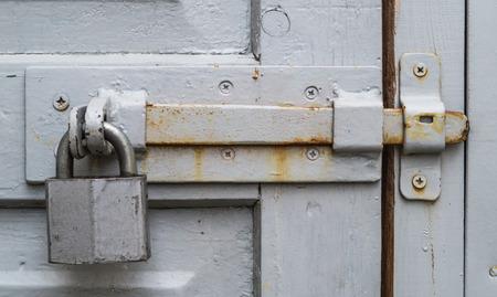 door bolt: Old bolt and padlock on the door
