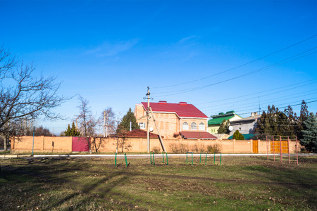street corner: A two-storey house behind a fence on a street corner Stock Photo