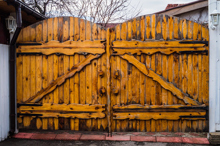 large doors: Old wooden gate in the street close up