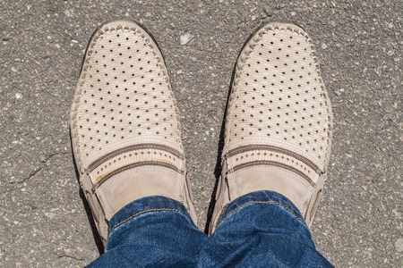 moccasins: Beige moccasins on their feet close up Stock Photo