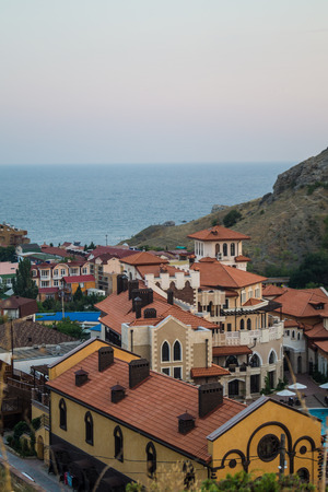 The village is surrounded on two sides by mountains and sea thereof