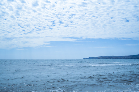 Seascape in a summer day, and the sky with billowing clouds