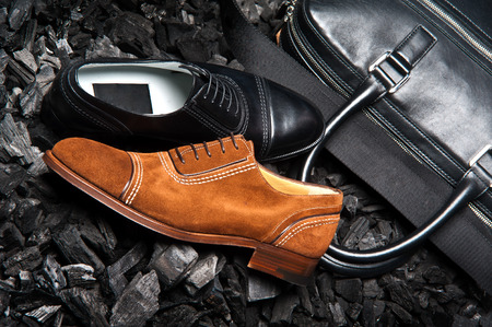 Stylish mens shoes on the coals photo