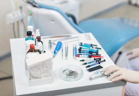 Dentist selecting his items. Dentist equipment. Stomatologist tools