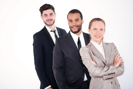 doings: Portrait of three businessmen. Three successful and smiling businessmen standing in a row on a white background isolation.