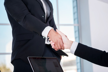 doings: Meeting business partners. Two businessman shaking hands with each other in the office Stock Photo