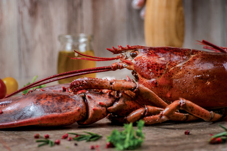 Seafood lobsters. Fresh beautiful large sea lobsters. Delicious lobster on a wooden table.