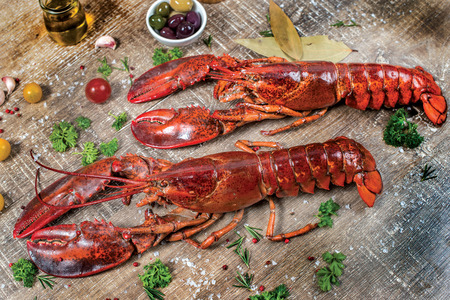 lobster dinner: Seafood lobsters. Fresh beautiful large sea lobsters. Delicious lobster on a wooden table.