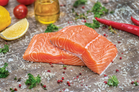 salmon fillet: Fillet of salmon. Fresh and beautiful salmon fillet on a wooden table. Delicious fish meat.