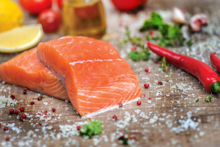 food ingredient: Fillet of salmon. Fresh and beautiful salmon fillet on a wooden table. Delicious fish meat.