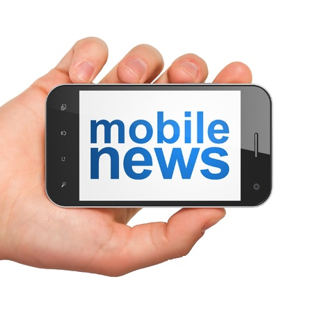 News concept  hand holding smartphone with word Mobile News on display  Generic mobile smart phone in hand on White background  photo