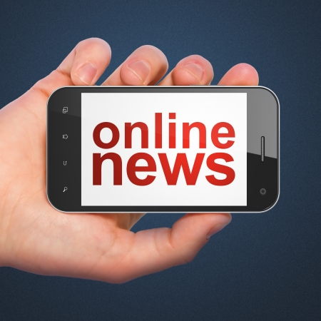 News concept  hand holding smartphone with word Online News on display  Generic mobile smart phone in hand on Dark Blue background  photo