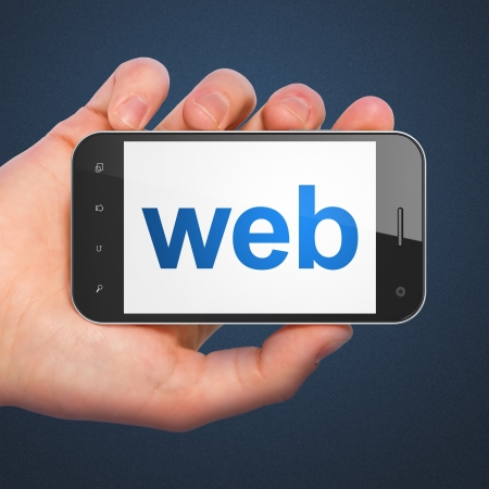 website words: SEO web development concept  hand holding smartphone with word Web on display  Generic mobile smart phone in hand on Dark Blue background  Stock Photo