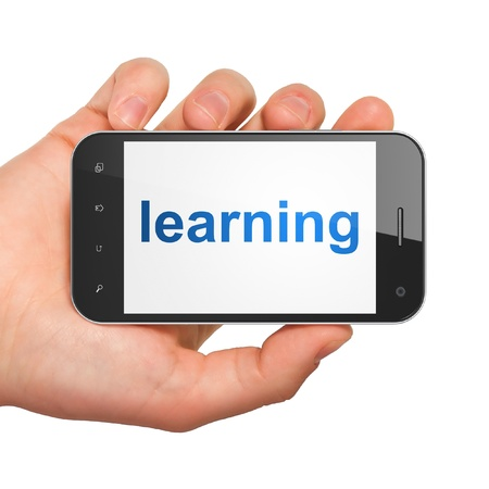 studing: Education concept  hand holding smartphone with word Learning on display  Generic mobile smart phone in hand on White background