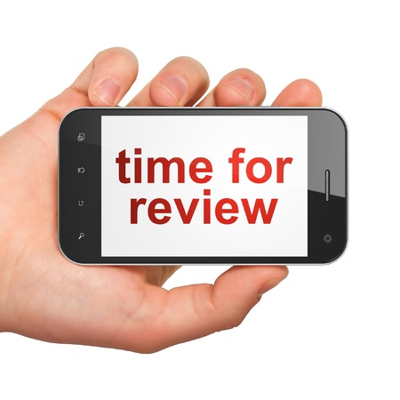 Timeline concept  hand holding smartphone with word Time for Review on display  Generic mobile smart phone in hand on White background  photo