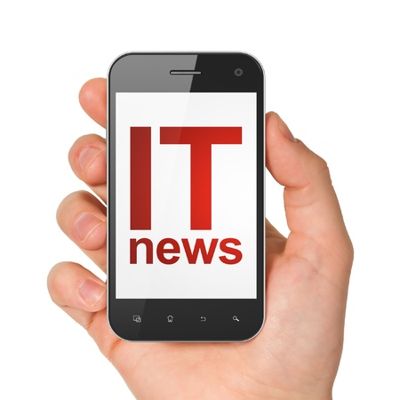 News concept  hand holding smartphone with word IT News on display  Generic mobile smart phone in hand on White background  photo