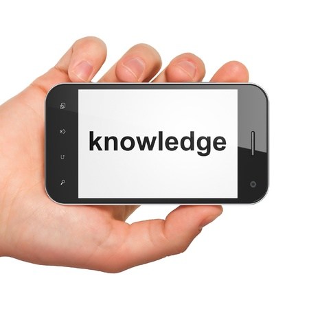studing: Education concept  hand holding smartphone with word Knowledge on display  Generic mobile smart phone in hand on White background