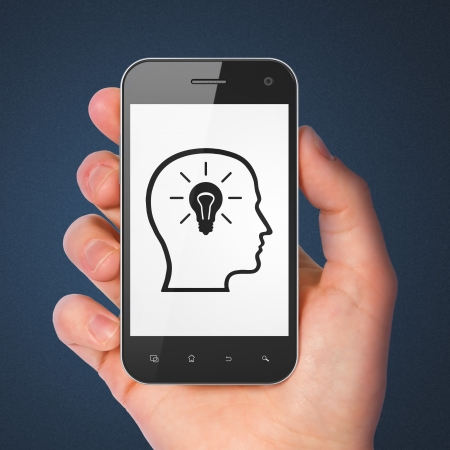 Information concept  hand holding smartphone with Head Whis Lightbulb on display  Generic mobile smart phone in hand on Dark Blue background  photo