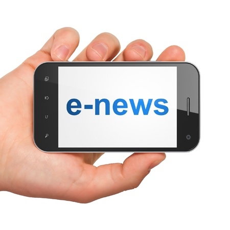 News concept  hand holding smartphone with word E-news on display  Generic mobile smart phone in hand on White background  photo