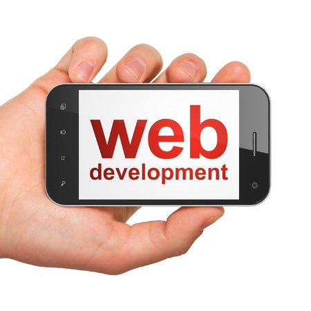 SEO web development concept: hand holding smartphone with word Web Development on display. Generic mobile smart phone in hand on White background. photo
