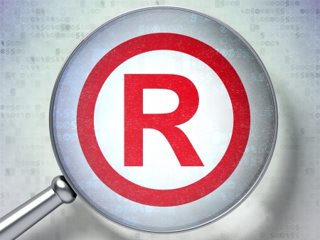 Law concept: magnifying optical glass with Registered icon on digital background, 3d render photo