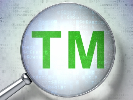 Law concept: magnifying optical glass with Trademark icon on digital , 3d render photo