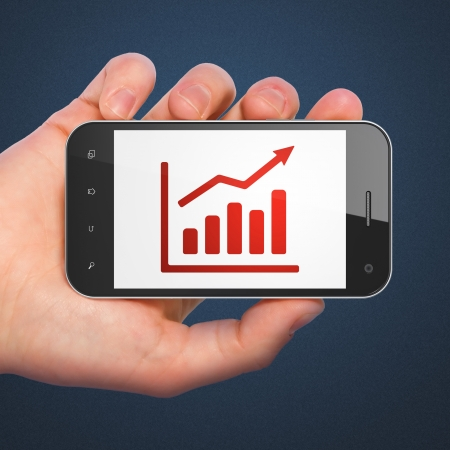 Business concept: hand holding smartphone with Growth Graph on display. Mobile smart phone in hand isolated on Blue , 3d render photo
