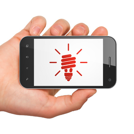 buisnes: Finance concept: hand holding smartphone with Energy Saving Lamp on display. Mobile smart phone in hand isolated on White , 3d render