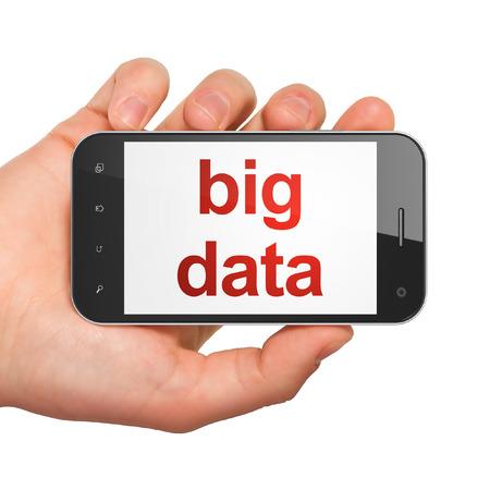 Concepto de datos: la celebraci�n smartphone con palabras grandes datos en la pantalla a mano. Tel�fono elegante m�vil en la mano sobre fondo blanco, 3d photo