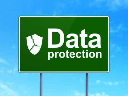 Security concept: Data Protection and Broken Shield icon on green road (highway) sign, clear blue sky background, 3d render photo