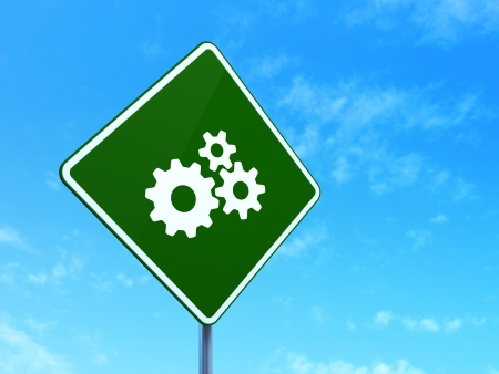 Business concept: Gears on green road (highway) sign, clear blue sky background, 3d render photo