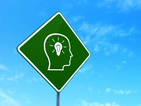 Finance concept: Head With Lightbulb on green road (highway) sign, clear blue sky background, 3d render photo