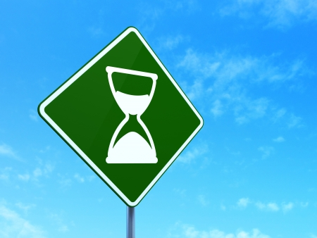 Timeline concept: Hourglass on green road (highway) sign, clear blue sky background, 3d render photo