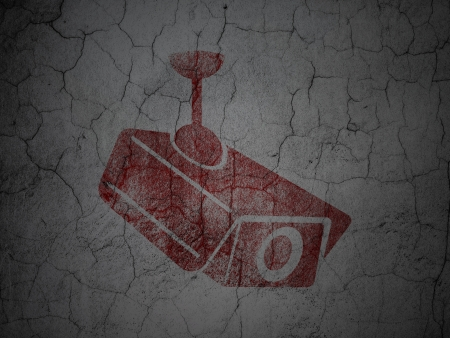 Security concept: Red Cctv Camera on grunge textured concrete wall background, 3d render photo