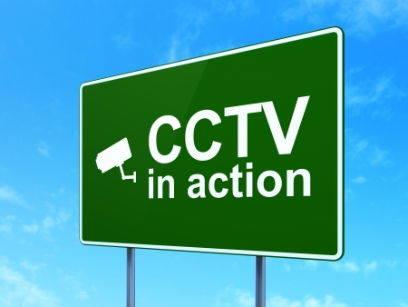 Safety concept: CCTV In action and Cctv Camera icon on green road (highway) sign, clear blue sky background, 3d render photo