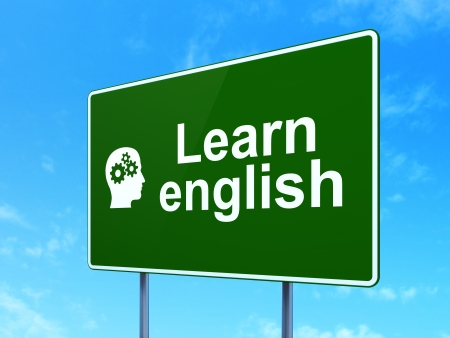 Education concept: Learn English and Head With Gears icon on green road (highway) sign, clear blue sky background, 3d render photo