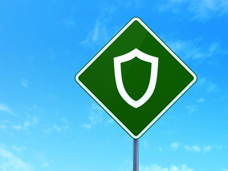 contoured: Safety concept: Contoured Shield on green road (highway) sign, clear blue sky background, 3d render Stock Photo