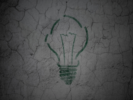 Business concept: Green Light Bulb on grunge textured concrete wall background, 3d render photo