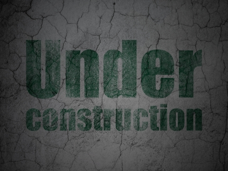 Web design concept: Green Under Construction on grunge textured concrete wall background, 3d render photo