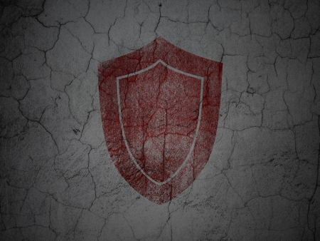 Safety concept: Red Shield on grunge textured concrete wall background, 3d render photo