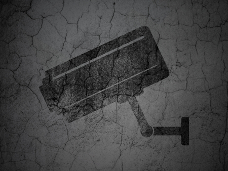 Security concept: Black Cctv Camera on grunge textured concrete wall background, 3d render photo